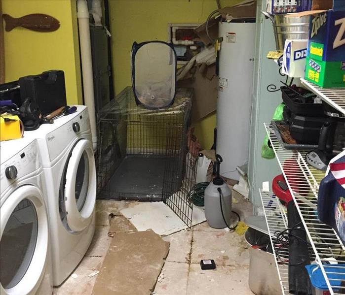 Flooded Laundry Room Due To Pipe Burst Before